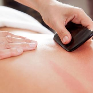 Gua Sha - Back being treated