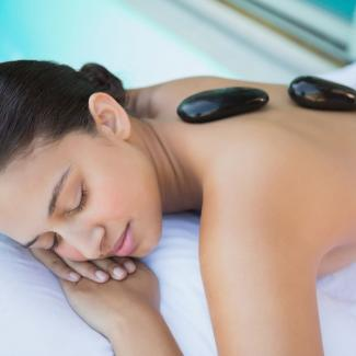 Hot Stone Massage - Woman in hot stone treatment